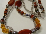 A Potpourri of Gemstones, Crystals, and Sterling Silver in Reddish Brown and Golden Hues