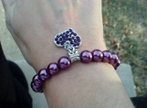 Purple bracelet with heart charm
