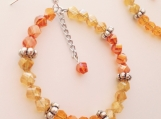 Crystal orange and yellow beaded hoop earrings with dangle chain center