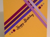 Happy birthday card in purple and yellow