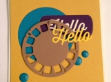 Hello card with inlaid die cut pieces