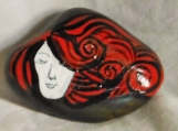 Redheaded woman on a Stone