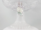 Vintage oblong pearl colored ice blue button dangling earrings