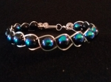 Braided silver plated wire and black bead bracelet