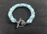 Hand beaded glass pearl and bead bracelet, totally hand beaded in turquoise crystal and white.