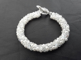 Pearl and crystal hand beaded bracelet  perfect for  bridal occasions.