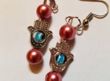 Pair of hamsa and evil eye protector