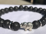 Essential Oil Diffusing Lava and a Tibetan Silver Elephant