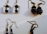 4 pairs of black earrings
