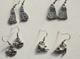 4 pairs of cat silver tone earrings