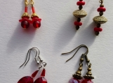4 pairs of red earrings