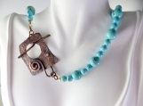 Turquoise beaded necklace with copper clasp