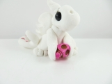 Clay white baby dragon with pink skull