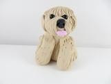 Clay tan dog sculpture figurine