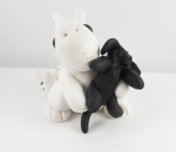 Clay white dragon sculpture figurine with a puppy